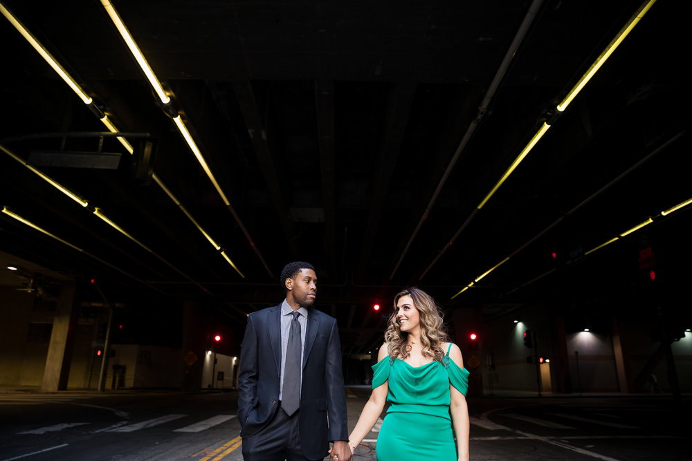 Danielle Ghaffari and CJ Watson.  Engagement Photos in downtown LA.   Luxury Wedding Planner Andrea Eppolito, with images by Brian Leahy.  Bride to be is wearing Green Tadashi Dress.