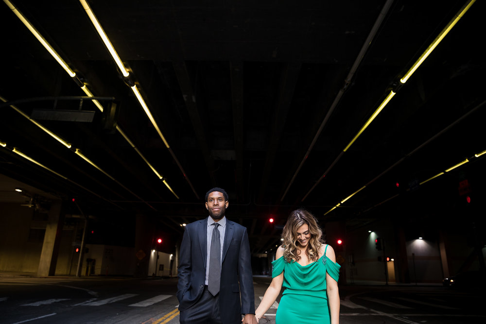 Couple laughing underground.Danielle Ghaffari and CJ Watson. Engagement Photos in downtown LA. Luxury Wedding Planner Andrea Eppolito, with images by Brian Leahy.