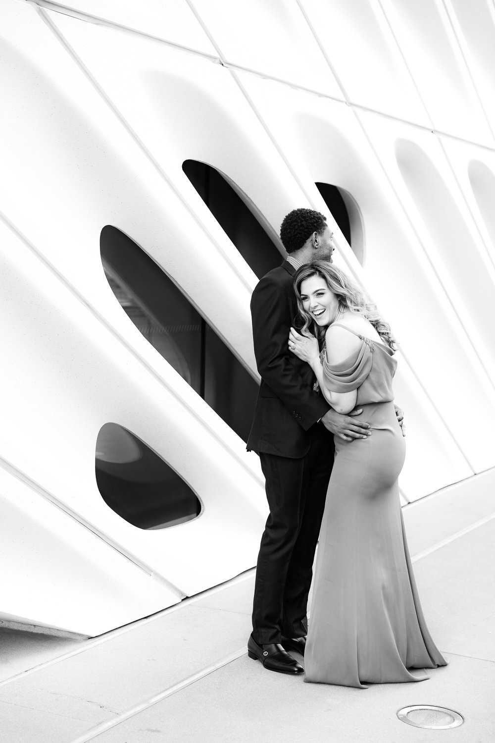 Black and white engagement photos at Disney Concert Hall.Danielle Ghaffari and CJ Watson. Engagement Photos in downtown LA. Luxury Wedding Planner Andrea Eppolito, with images by Brian Leahy.