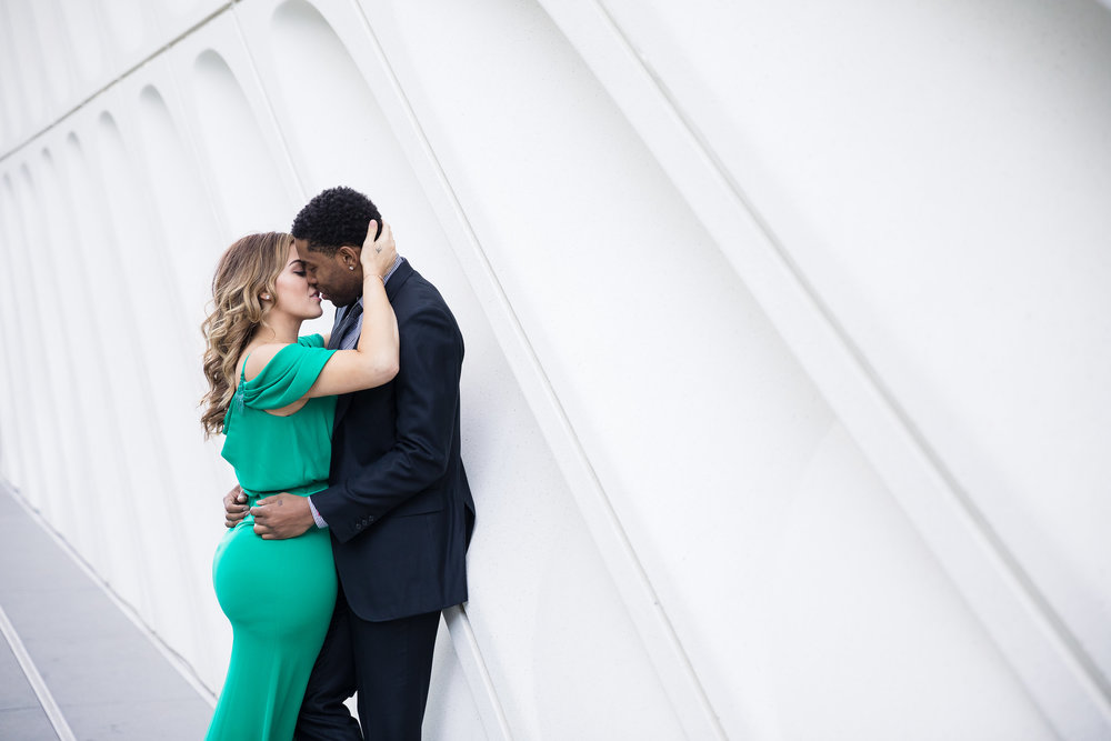 Kisses at the Disney Concert Hall.Danielle Ghaffari and CJ Watson. Engagement Photos in downtown LA. Luxury Wedding Planner Andrea Eppolito, with images by Brian Leahy.