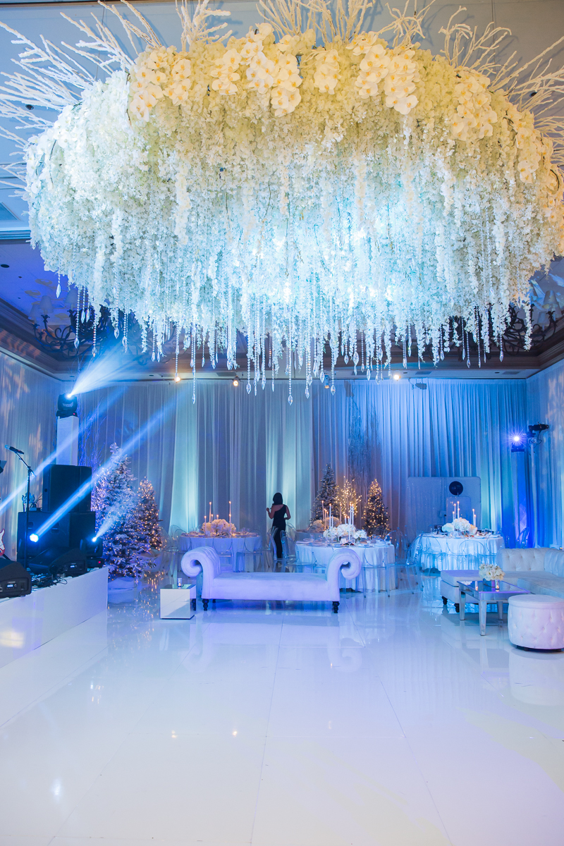 White on white wedding.  White flooring and ceiling.  Las Vegas Wedding Planner Andrea Eppolito and Photo by Stephen Salazar.