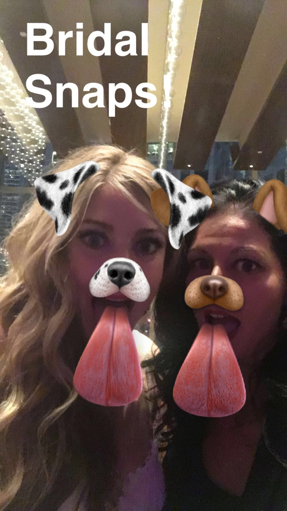 Wedding planner and bride playing on snapchat.