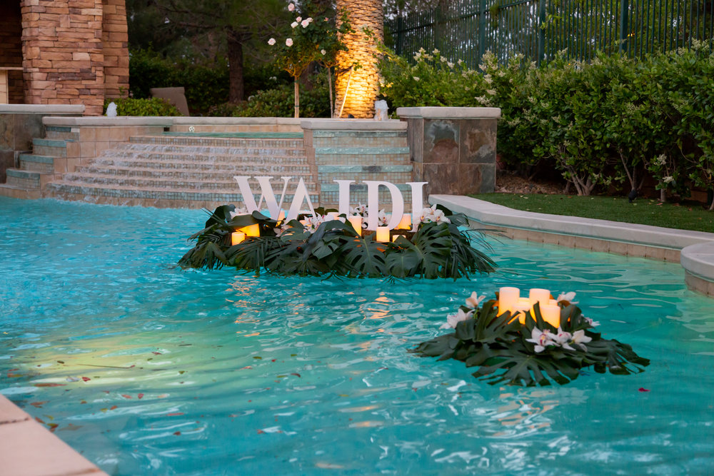 Pool decorations for a birthday party.  Las Vegas Event Planner Andrea Eppolito planned a Havana Nights Birthday Party for Pop Star Wajdi Kassas.  By Dzign provided all decor, with lighting from LED UNplugged and photos by Adam Frazier.
