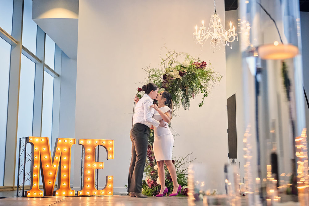 She said yes!  Surprise Proposal.  Las Vegas Wedding Planner Andrea Eppolito designed the surprise engagement at the Mandarin Oriental for two brides to be.  Decor and lighting by Flora Couture and LED Unplugged, with photos by Fabio and Adri.