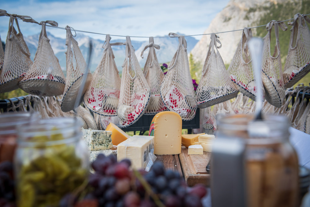 Delicious displays of fruit and cheese with super fun bags of plates & cups.  Photo by Carla Ten Eyck.