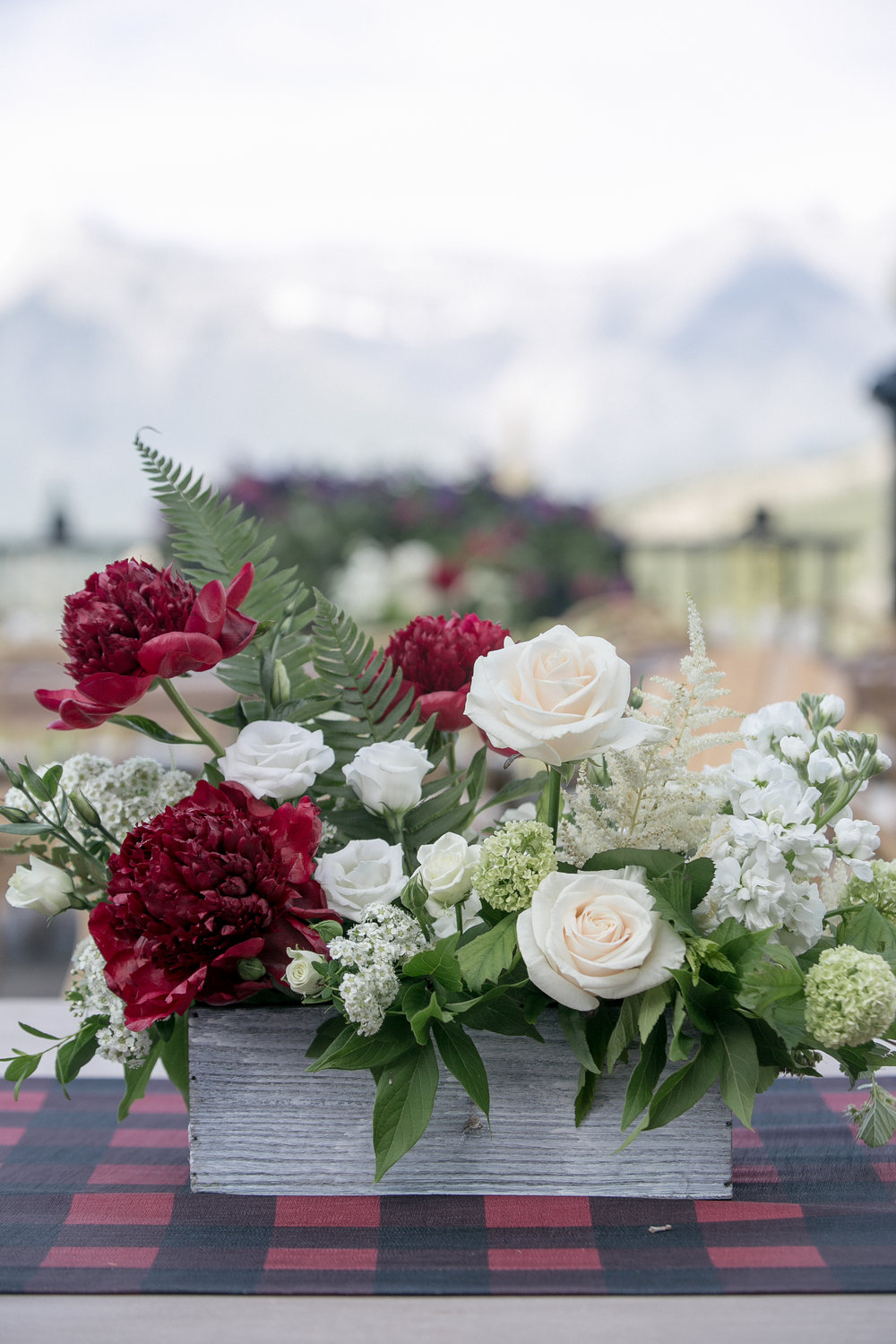 Canadian colors inspired our centerpieces at the welcome reception. Love Life Images. l