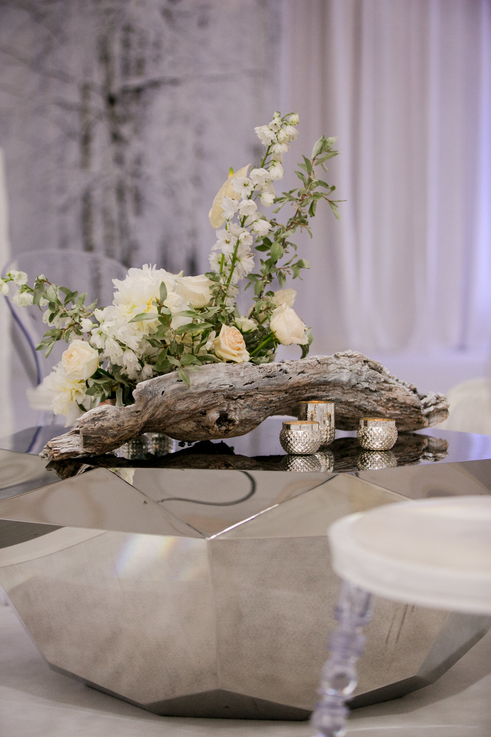 These centerpieces were the perfect blend of rustic and elegant.  The white washed birchwood was a beautiful base for the florals.  The Engage Gala in Banff Canada.  Photo by Genevieve deMaio Photography.  Creative Design by Angela Desveaux of Wedluxe.  Partners include Revelry Event Designers, Modern Luxe Rentals, West Coast Music, La Tavola Linen, Decor and More, Engineered Arts, and Designer Dance Floors,.