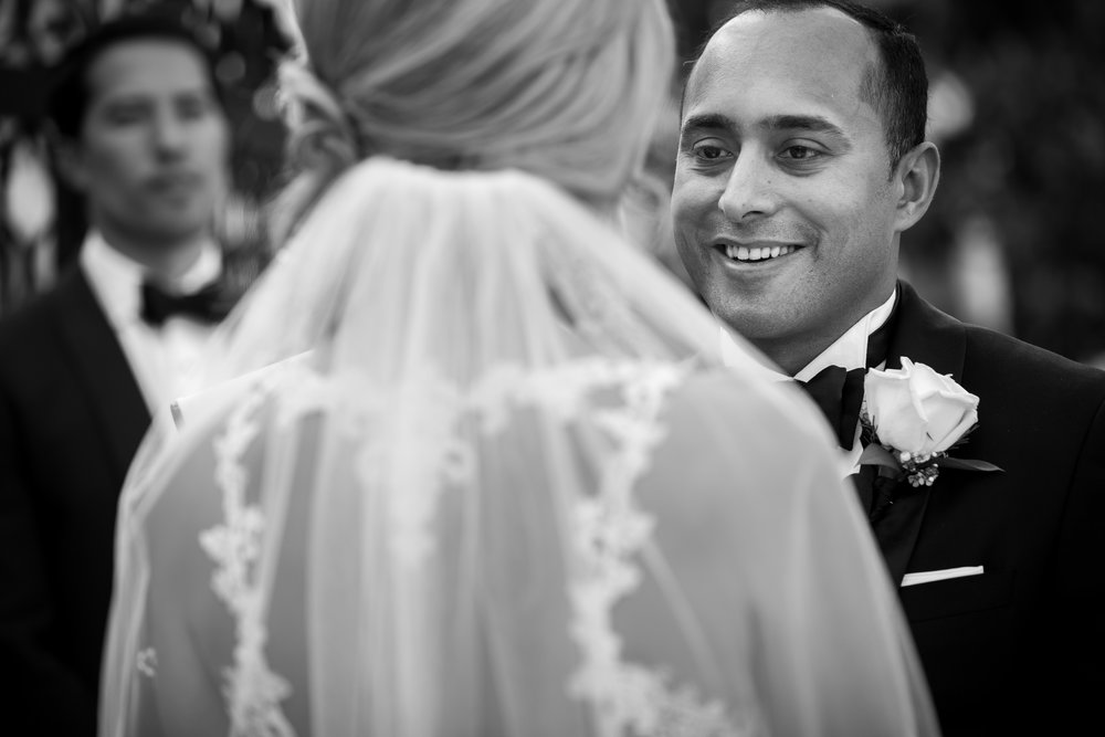 Groom at Wedding Ceremony at Bellagio.Wedding Planner:  Andrea Eppolito Events   | Photography  D2 Tuscan Wedding Photography  | Videography  M Place Productions  | Venue & Catering:  Bellagio  | Floral & Decor:  Destinations by Design  | Lighting:  LED Unplugged   | Music: Classical Entertainment &  DJ Mike Fox  | Hair & Make Up:  Amelia C & Co