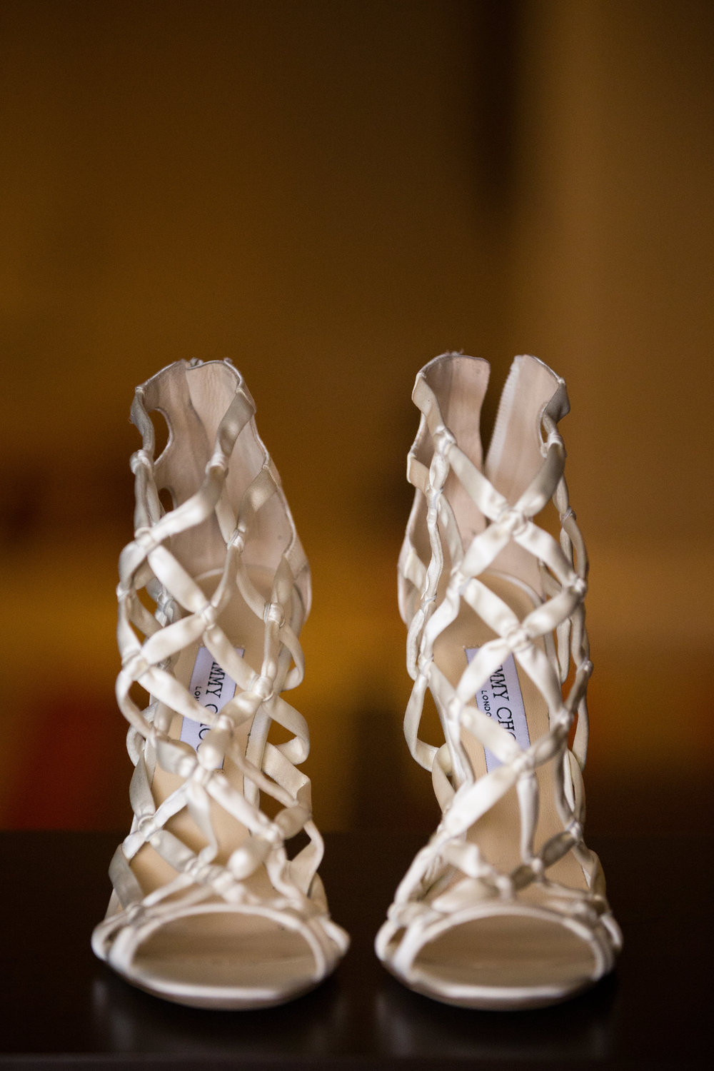 Jimmy Choo satin cage sandels.  Wedding Planner:  Andrea Eppolito Events   |   Photography  D2 Tuscan Wedding Photography   |  Videography  M Place Productions   |  Venue & Catering:  Bellagio   |  Floral & Decor:  Destinations by Design    |  Lighting:  LED Unplugged   |  Music: Classical Entertainment &  DJ Mike Fox   |  Hair & Make Up:  Amelia C & Co