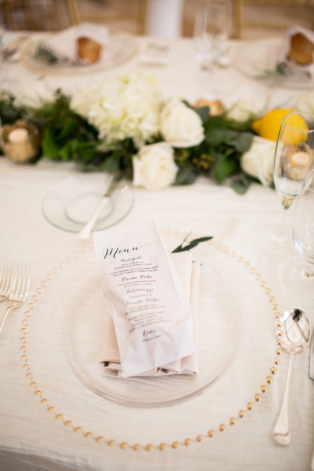 Menu printed on bread bag.   Wedding Planner:  Andrea Eppolito Events   |   Photography  D2 Tuscan Wedding Photography   |  Videography  M Place Productions   |  Venue & Catering:  Bellagio   |  Floral & Decor:  Destinations by Design    |  Lighting:  LED Unplugged   |  Music: Classical Entertainment &  DJ Mike Fox   |  Hair & Make Up:  Amelia C & Co