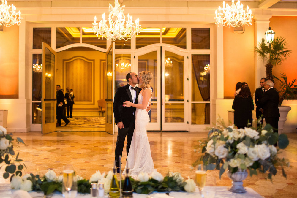First Dance at Bellagio.Wedding Planner:  Andrea Eppolito Events   | Photography  D2 Tuscan Wedding Photography  | Videography  M Place Productions  | Venue & Catering:  Bellagio  | Floral & Decor:  Destinations by Design  | Lighting:  LED Unplugged   | Music: Classical Entertainment &  DJ Mike Fox  | Hair & Make Up:  Amelia C & Co