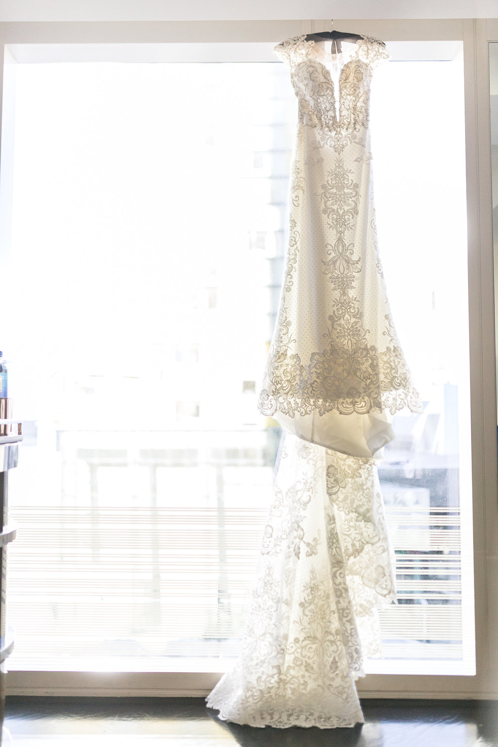 lace wedding dress.  Wedding Planner:  Andrea Eppolito Events  |   Photography  Brian Leahy   |  Videography  HOO Films   |  Venue & Catering:  Mandarin Oriental  / Waldorf Astoria |  Floral & Decor:  Destinations by Design    |  Lighting:  LED Unplugged  |  Music:  DJ Breeze II   |  Hair & Make Up:  Amelia C & Co