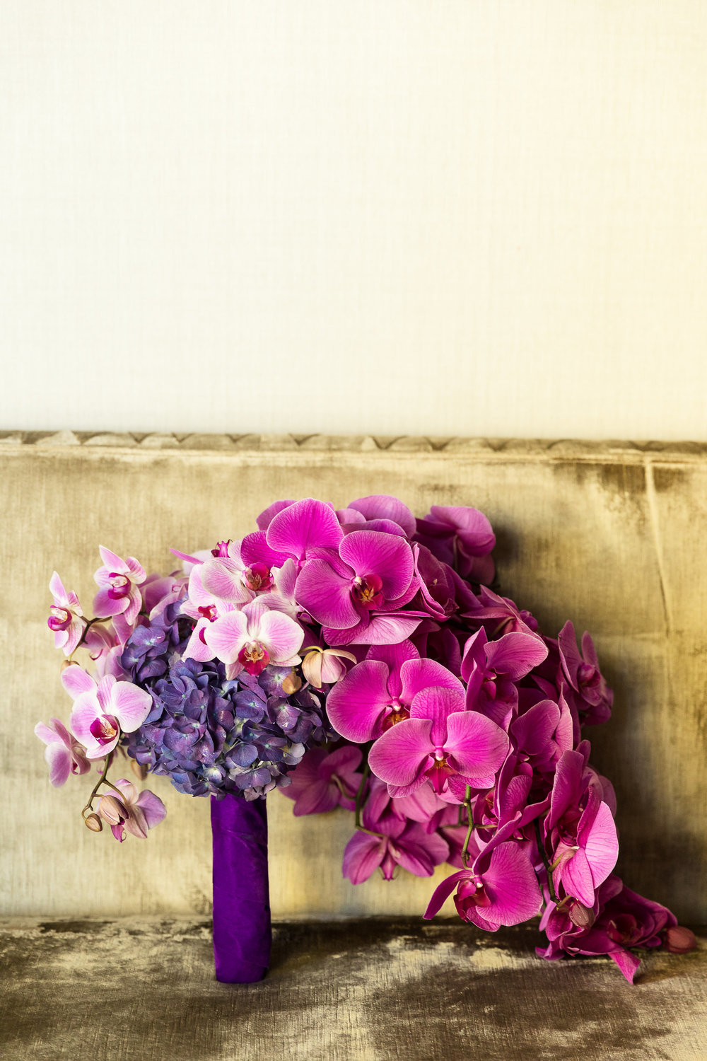 Purple bouquet with orchids, roses, and hydrangea.  Wedding Planner:  Andrea Eppolito Events  |   Photography  Brian Leahy   |  Videography  HOO Films   |  Venue & Catering:  Mandarin Oriental  / Waldorf Astoria |  Floral & Decor:  Destinations by Design