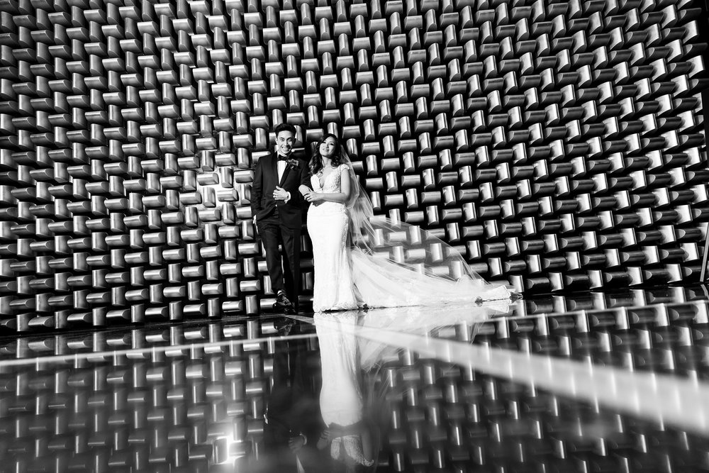 Black and white wedding portraits at the gold wall.  Wedding Planner:  Andrea Eppolito Events  |   Photography  Brian Leahy   |  Videography  HOO Films   |  Venue & Catering:  Mandarin Oriental  / Waldorf Astoria |  Floral & Decor:  Destinations by Design    |  Lighting:  LED Unplugged  |  Music:  DJ Breeze II   |  Hair & Make Up:  Amelia C & Co   |  Invitations by  Bliss & Bone   |  Menu and Escort Cards by  Meldeen