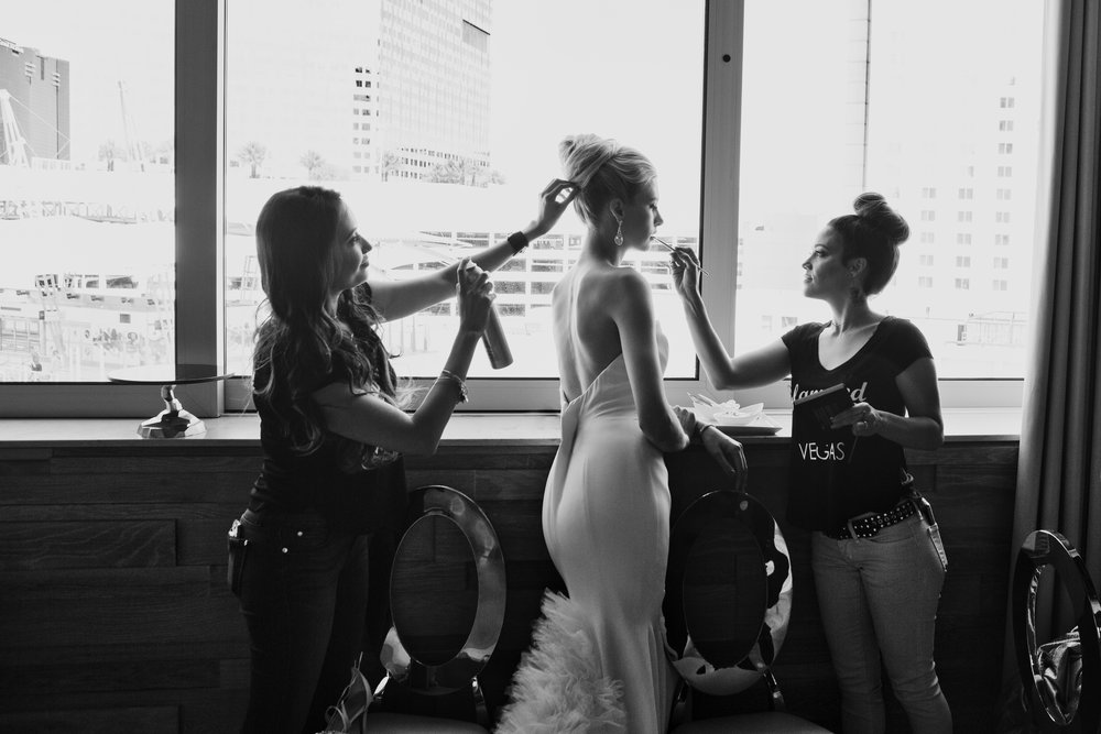Behind the scenes of bridal glam at the wedding.  Las Vegas Wedding Planner & Event Designer  Andrea Eppolito Events  · Photography by  Adam Frazier Photo  · Video by  M Place Productions  · Floral & Decor by  DBD Las Vegas  · Venue  ARIA Primrose Ballroom  · Cigar Band by  Royal Cigar Company  and  Jason of Beverly Hills  · Beauty by  Glammed Up Las Vegas  · Dress by  Vera Wang  · Salon  Couture Bride Las Vegas  · Shoes  Bella Belle Shoes  · Bride  Katrina May Armenta  · Groom  Lucas Cuevas