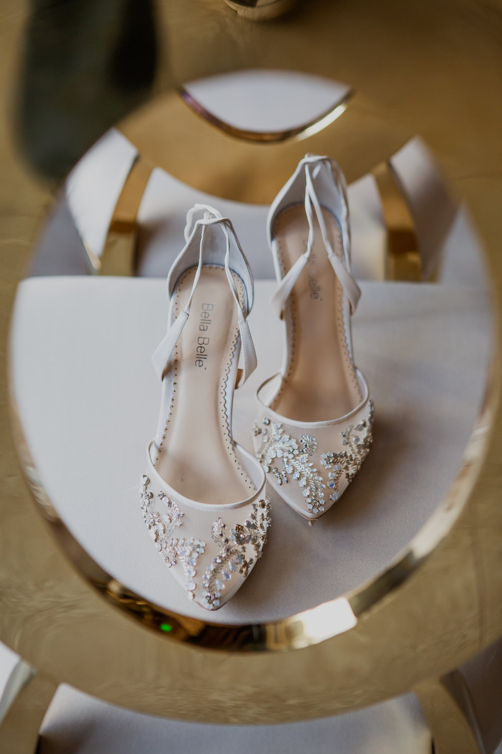 Bella Belle embroidered wedding shoes.  Las Vegas Wedding Planner & Event Designer  Andrea Eppolito Events  · Photography by  Adam Frazier Photo  · Video by  M Place Productions  · Floral & Decor by  DBD Las Vegas  · Venue  ARIA Primrose Ballroom  · Cigar Band by  Royal Cigar Company  and  Jason of Beverly Hills  · Beauty by  Glammed Up Las Vegas  · Dress by  Vera Wang  · Salon  Couture Bride Las Vegas  · Shoes  Bella Belle Shoes  · Bride  Katrina May Armenta  · Groom  Lucas Cuevas