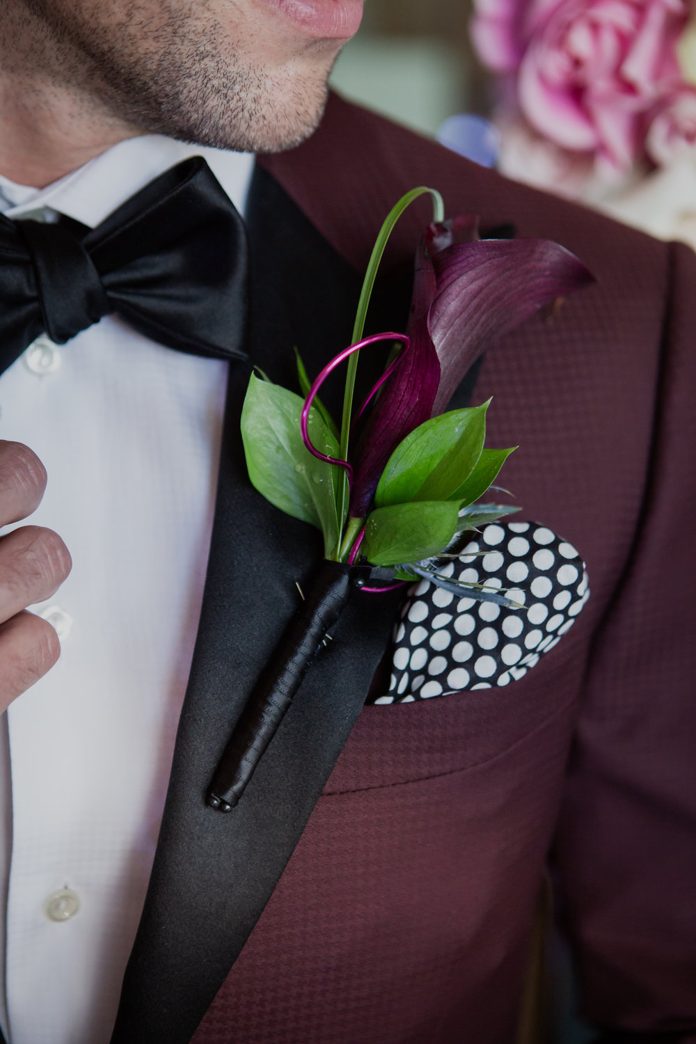 Dark purple calla Lilly boutonniere. Maroon tuxedo. Las Vegas Wedding Planner & Event Designer  Andrea Eppolito Events  · Photography by  Adam Frazier Photo  · Video by  M Place Productions  · Floral & Decor by  DBD Las Vegas  · Venue  ARIA Primrose Ballroom  · Cigar Band by  Royal Cigar Company  and  Jason of Beverly Hills  · Beauty by  Glammed Up Las Vegas  · Dress by  Vera Wang  · Salon  Couture Bride Las Vegas  · Shoes  Bella Belle Shoes  · Bride  Katrina May Armenta  · Groom · Tuxedo