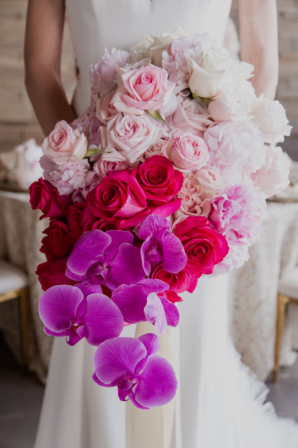 Full and lush ombre bouquet. Las Vegas Wedding Planner & Event Designer  Andrea Eppolito Events  · Photography by  Adam Frazier Photo  · Video by  M Place Productions  · Floral & Decor by  DBD Las Vegas  · Venue  ARIA Primrose Ballroom  · Cigar Band by  Royal Cigar Company  and  Jason of Beverly Hills  · Beauty by  Glammed Up Las Vegas  · Dress by  Vera Wang  · Salon  Couture Bride Las Vegas  · Shoes  Bella Belle Shoes  · Bride  Katrina May Armenta  · Groom  Lucas Cuevas