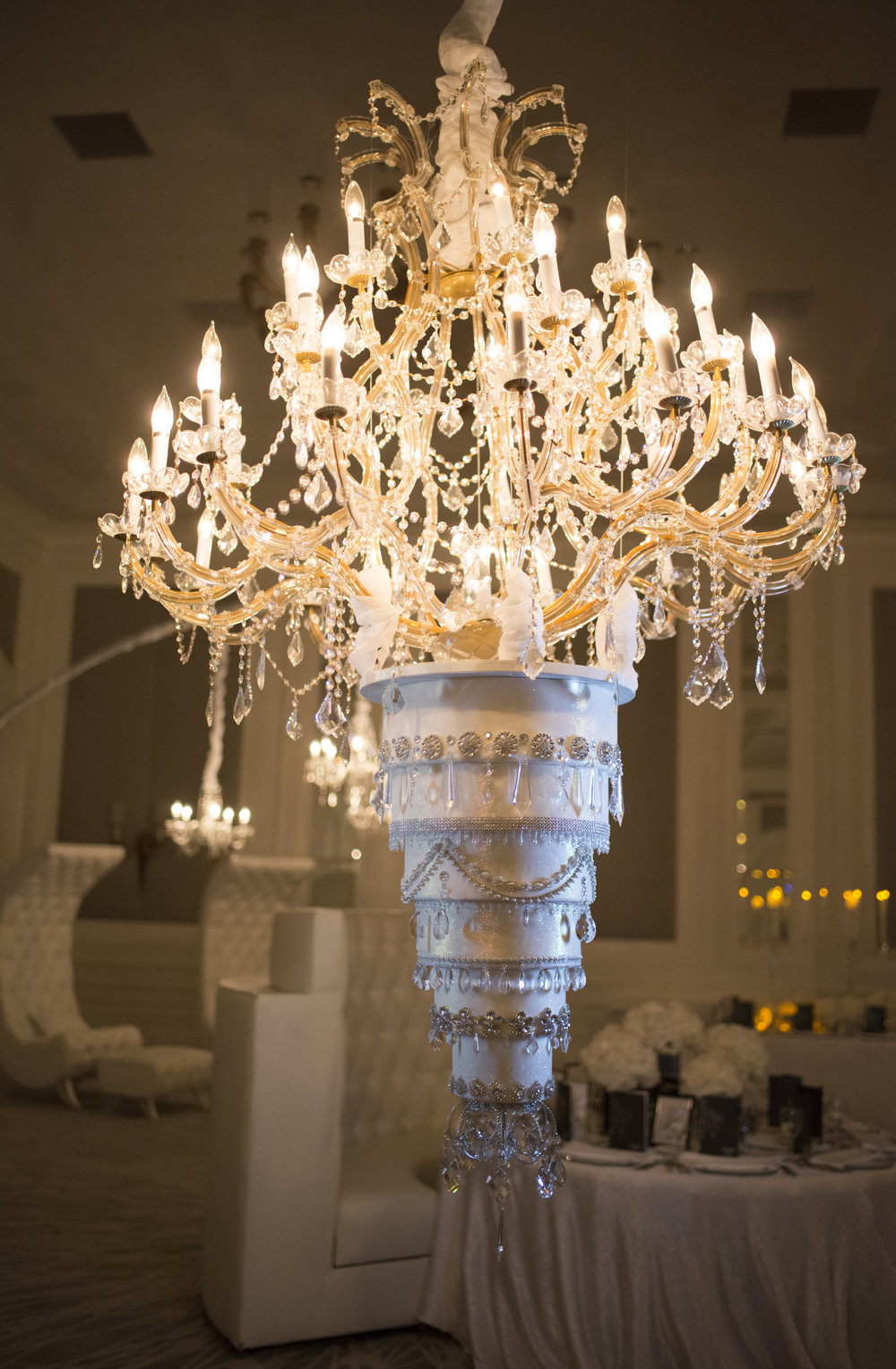 Upside down wedding cake hanging by a chandelier. Las Vegas Wedding Planner Andrea Eppolito. Cake by Four Seasons. Photo by AltF.