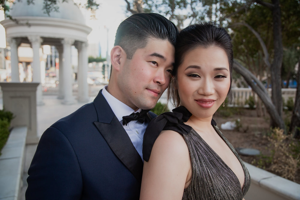 Beautiful asian couple in formal engagement photos. Often times, Asian brides want to work with make up artists who understand how to make them look their best, and Glammed Up Las Vegas did not disappoint!  Las Vegas Engagement Photos. Visit Wedding Planner www.andreaeppolitoevents.com to learn more! Photo by Adam Frazier.
