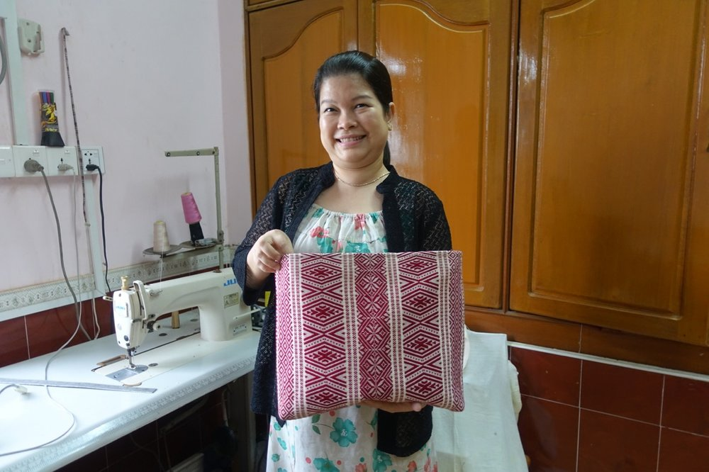 Thin Myat Soe , the amazing Thin Thin is a designer on the rise in the new Yangon fashion scene. Her roots go deep in the city and her memory is long but Thin Thin is a modern woman and always on the lookout for what's new. She is a graduate of Yangon University, and a young mom, who lives atop her mother-in-law's dress making shop in the hippest part of Yangon's downtown. Thin Thin is a perfectionist so it's no surprise that she has emerged as an in demand bag designer and we look forward to the launch of her own clothing line.