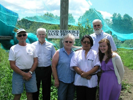 Growing project members pose in  front of the blueberry bushes at Bluejay Orchard with overseas guest, Zayda Reyes, from the Mateare Carazo Program in Nicaragua.