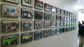 Two walls in the Mission Station are covered by photos of work groups. Photo Credit: Zach Wolgemuth
