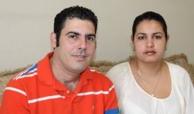 Yunior and his wife Raysa at home in Miami, Florida. CWS Photo by Phillip Rincon.