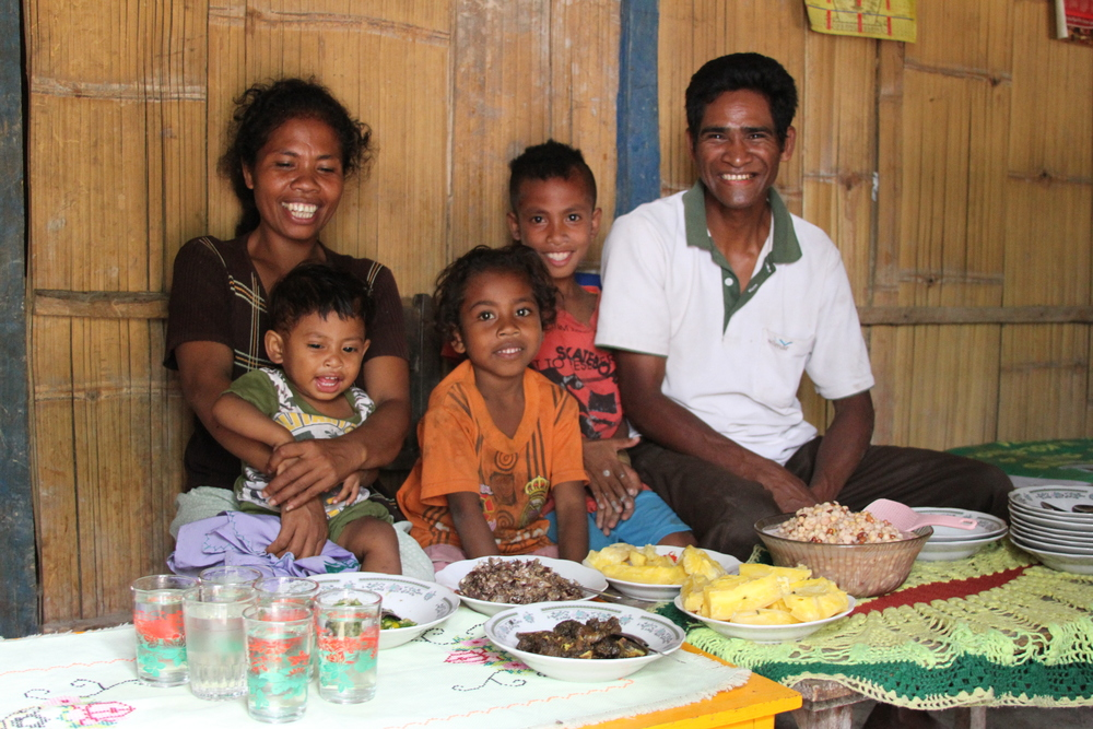 A family sits down for a meal in Soe, Indonesia. Lisa Hayes/CWS