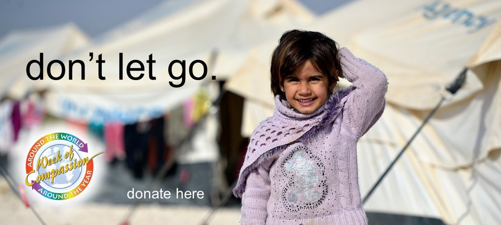 A girl in the Zaatari Refugee Camp, located near Mafraq, Jordan. Opened in July, 2012, the camp holds upwards of 50,000 refugees from the civil war inside Syria. Week of Compassion through partners is active in the camp providing essential items and services. Photo: Paul Jeffrey