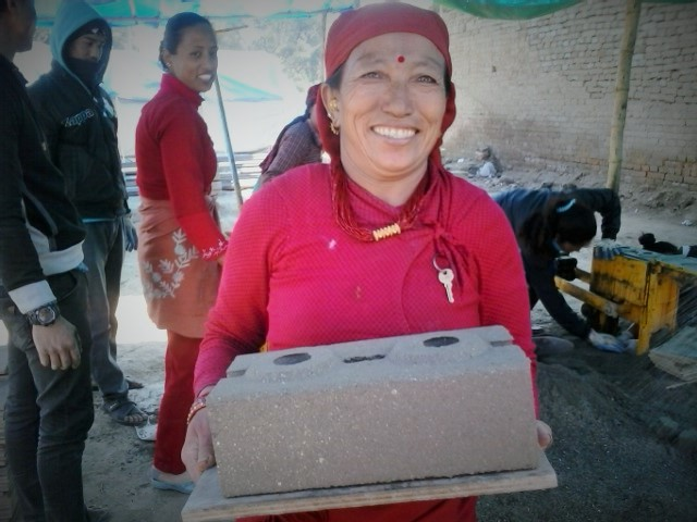 Kabita's friend, Kanchi Shrestha, carrying a raw brick she made for reconstruction work in Nepal after the earthquake. Photo: LWF/ Lucia de Vries