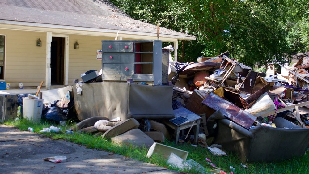 Debris piles awaiting collection in Denham Springs, a suburb of Baton Rouge