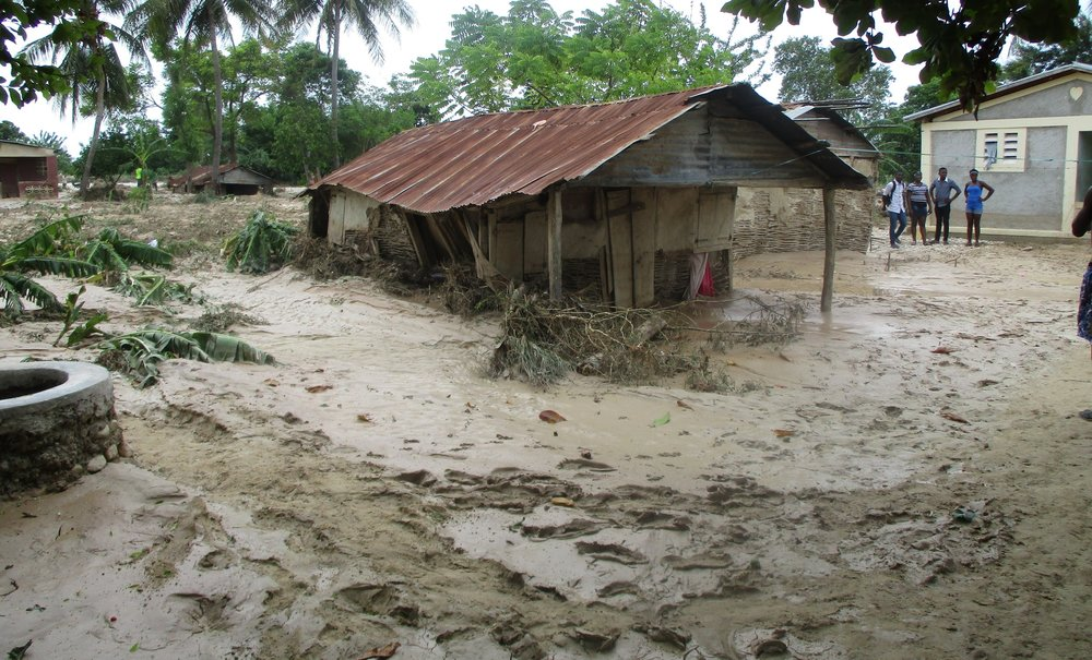 Haitian homes sunk into mud stirred up by Hurricane Matthew. Photo: Margot DeGreef/ACT Alliance