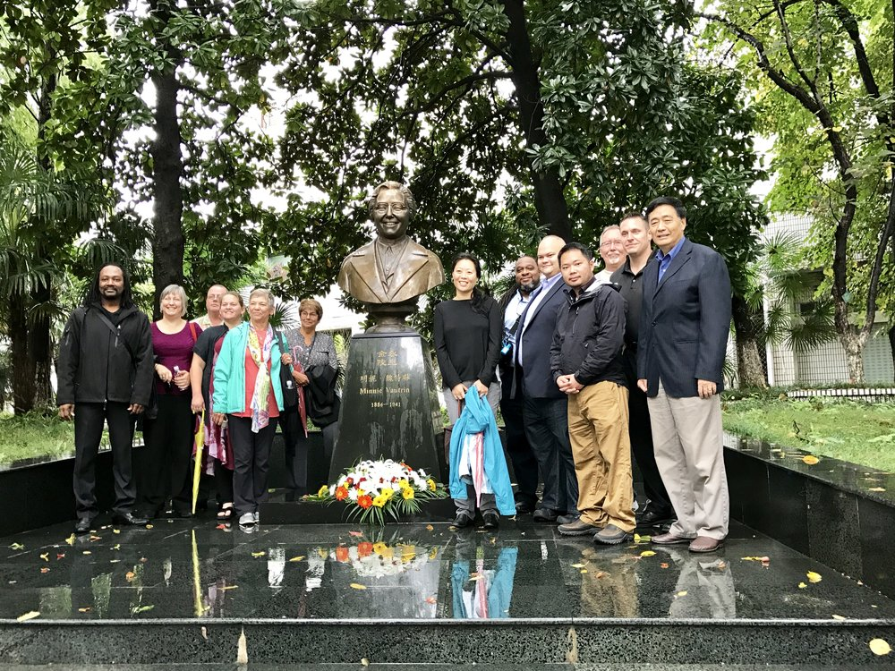 Committee for Week of Compassion members stand with statue of Minnie Vautrin in Nanjing, China