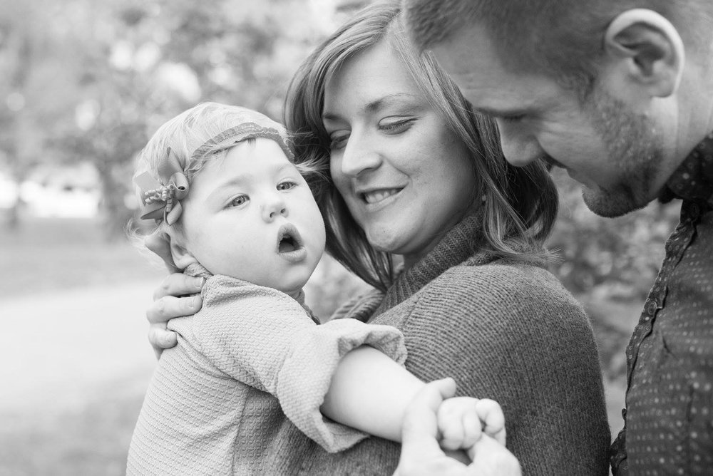 Milly in her favorite place - holding and being held. Photo credit: Katie Lindgren Photography