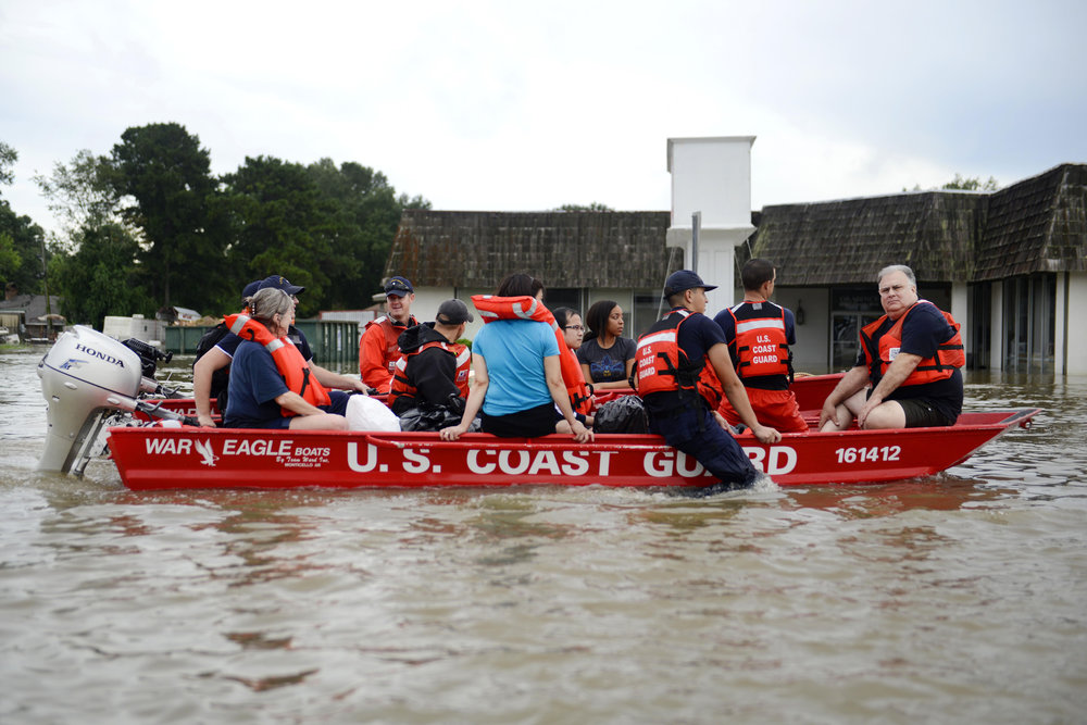 Stranded residents are rescued   from high water during severe flooding around Baton Rouge, LA on Aug. 14, 2016. Coast Guard photo by Brandon Giles