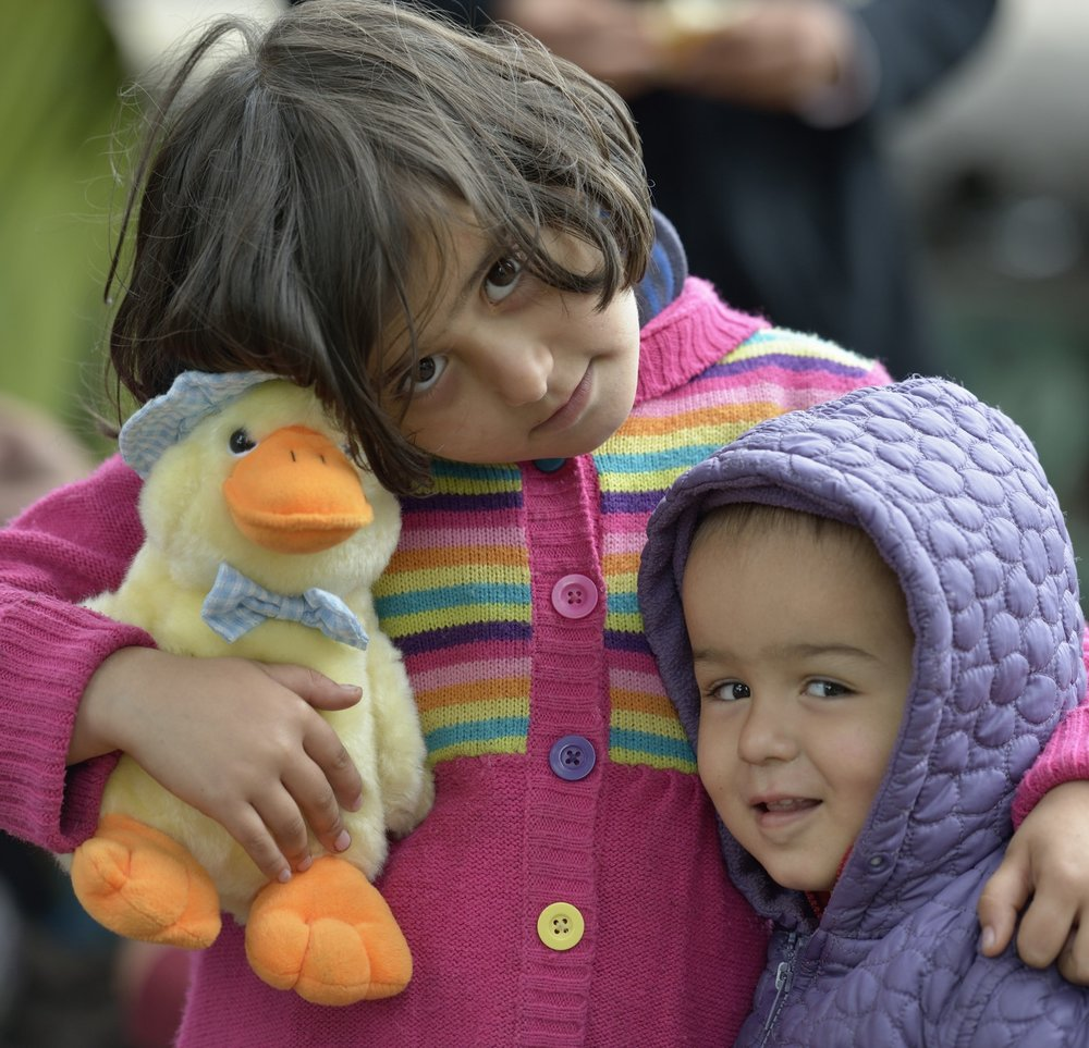 Photo: Paul Jeffrey           Six-year old Miriam, a refugee from Afghanistan, holds her stuffed toy duck as she embraces her little brother inside a refugee processing center in the Serbian village of Presevo, not far from the Macedonian border. Hundreds of thousands of refugees and migrants--including many children--have flowed through Serbia in 2015, on their way from Syria, Iraq and other countries to western Europe. The ACT Alliance has provided critical support for refugee and migrant families here and in other places along their journey. *Parental consent obtained