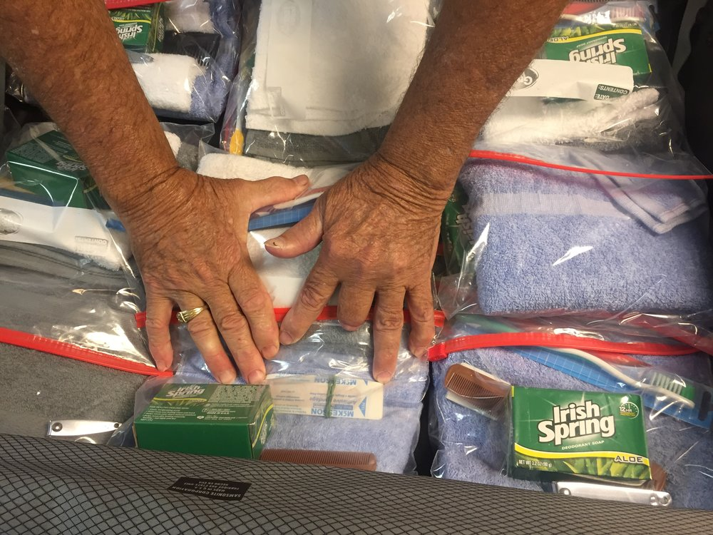 Church members in Neosho, MO prepare hygiene kits for communities affected by Hurricane Harvey and other disasters.