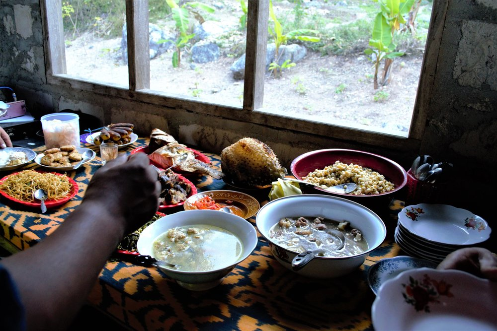 Seminarian Foster Frimpong shares in the feast provided in the Saenam village of West Timor.Photo by Kyle McDougall