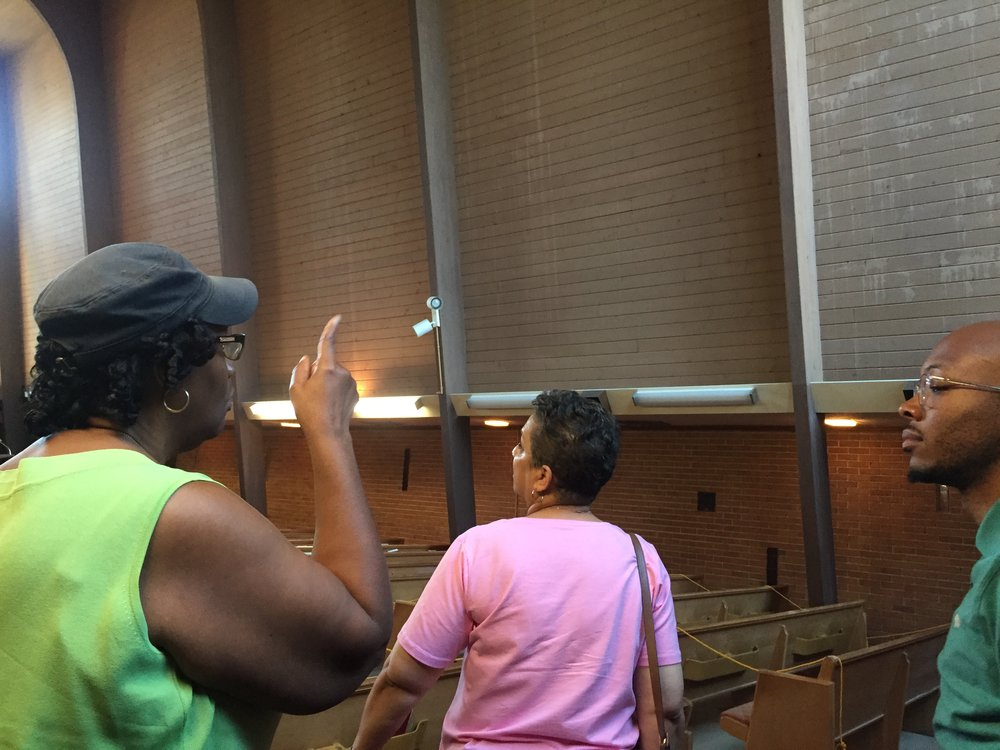 Member Angela Wright shows Rev. Owens damage at University Christian in Houston along with Pastor Darnell Fennell