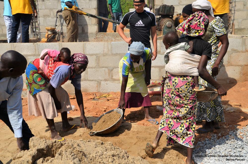 Women of Northern Nigeria work to rebuild their church building. [photo: Brethren Disaster Ministries]