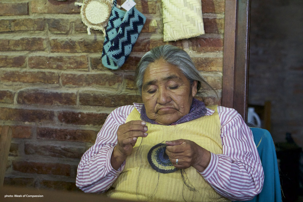 An indigenous  woman of the  Chaco region in  Paraguay works  on a craft to sell  at market.  [photo: Week of  Compassion]