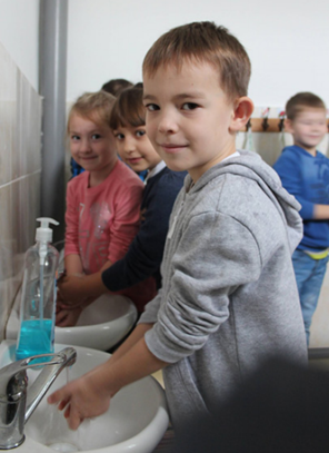 School children benefit from the availability of hot water. Photo Credit CWS