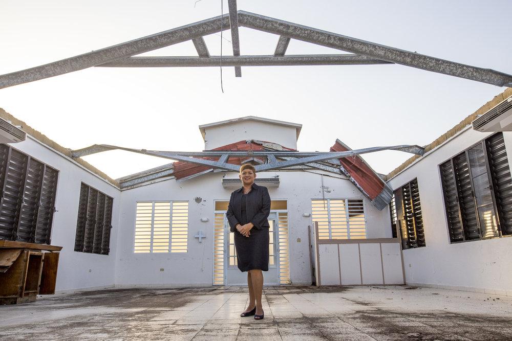 Photo credit: Craig Thompson   Pastora Milly Cortes, minister at Iglesia Cristian (Discipulos de Cristo) La Grama, describes the impact of Hurricane Maria on their neighborhood in Ciales, PR.