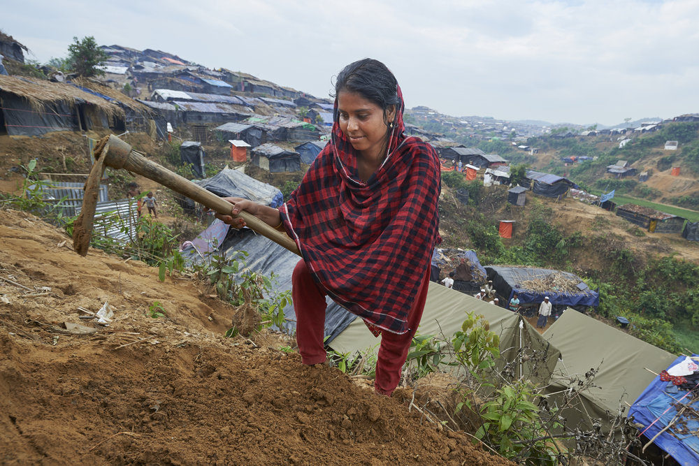 Photo credit: Paul Jeffrey/ACT Alliance   Romzima Begom, 25, grades the earth in front of her makeshift shelter in the Chakmarkul Refugee Camp near Cox's Bazar, Bangladesh, where Week of Compassion partners through the ACT Alliance provide humanitarian support for the refugees.