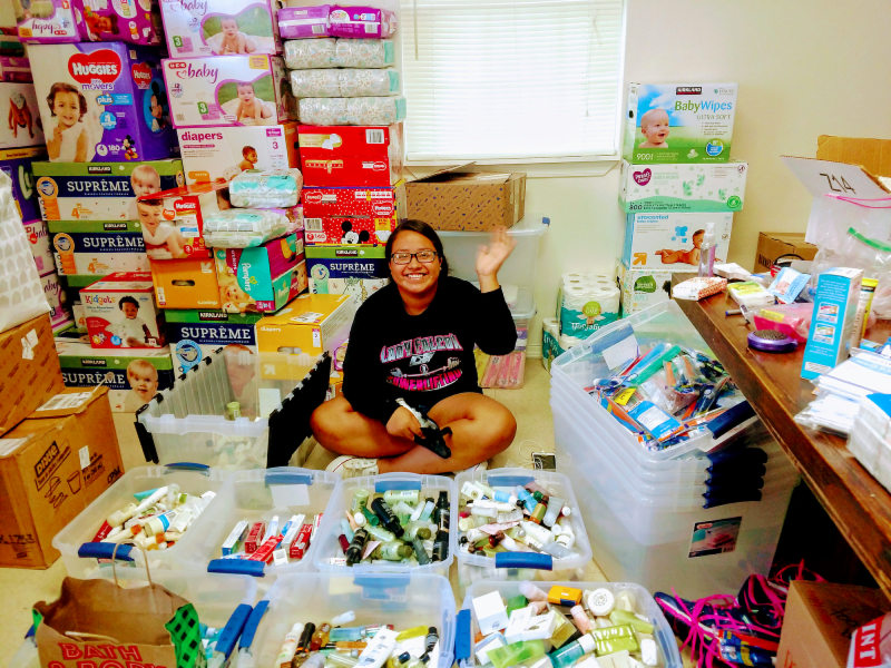 A volunteer sorts donated hygiene supplies at Southwest Good Samaritan Ministries. Photo: SGSM