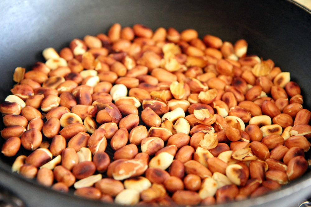 Roasted Peanuts. Remove peel by rubbing the peanuts between your fingers and fanning away the peel. Make sure to do this outside.