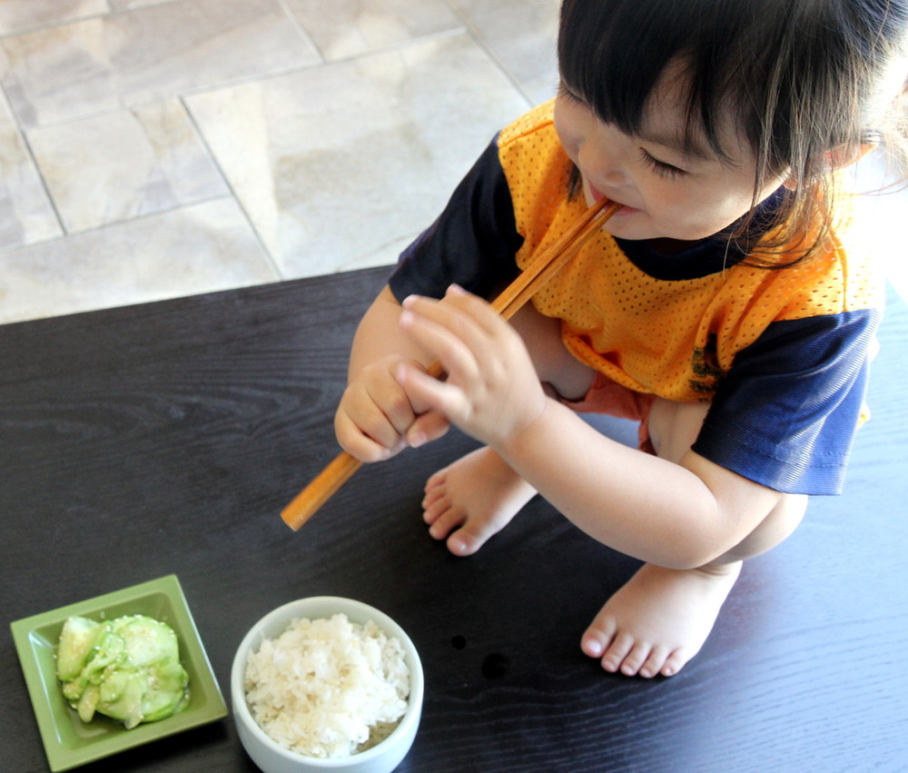 Allyson Le, 2, enjoying her rice and Japanese Cucumber Salad