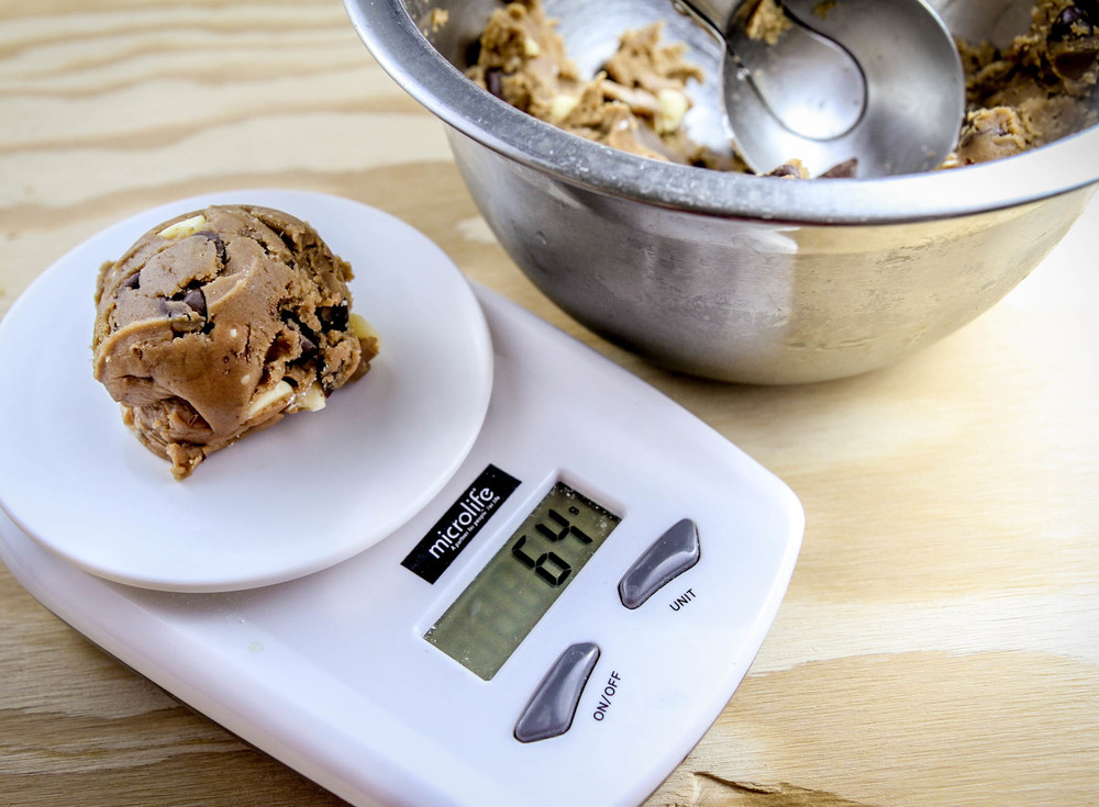 I like to use a small food scale to make sure all my cookies are of equal size.