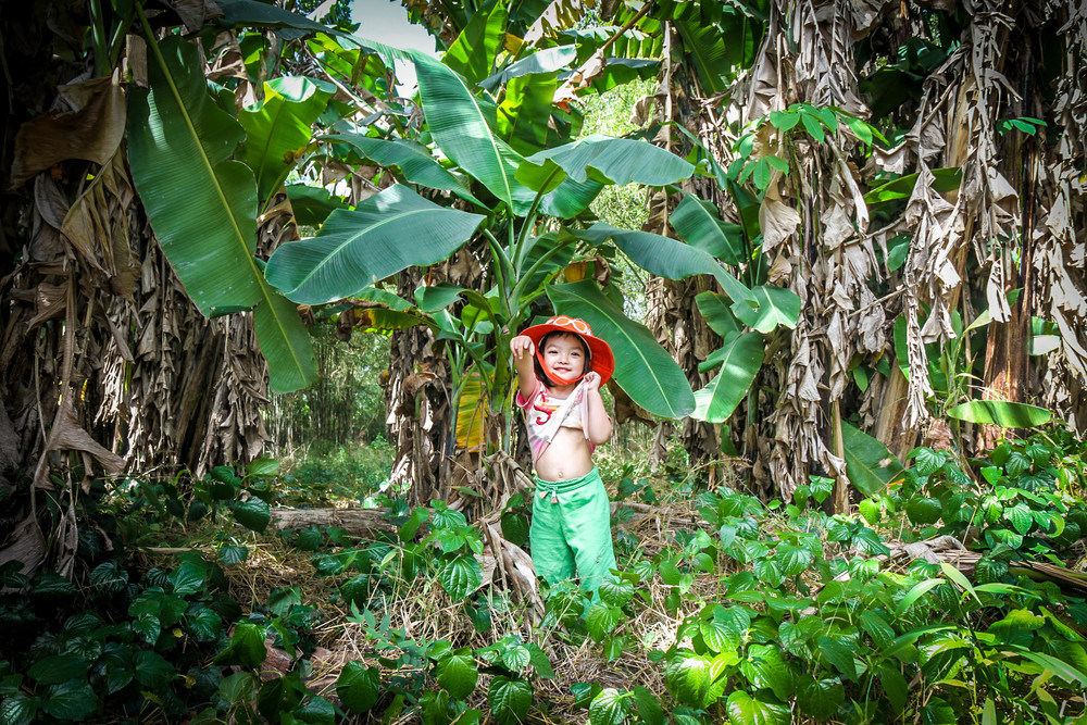 My daughter showing her sexy abs in the jungle of Vietnam (Uncle's backyard).